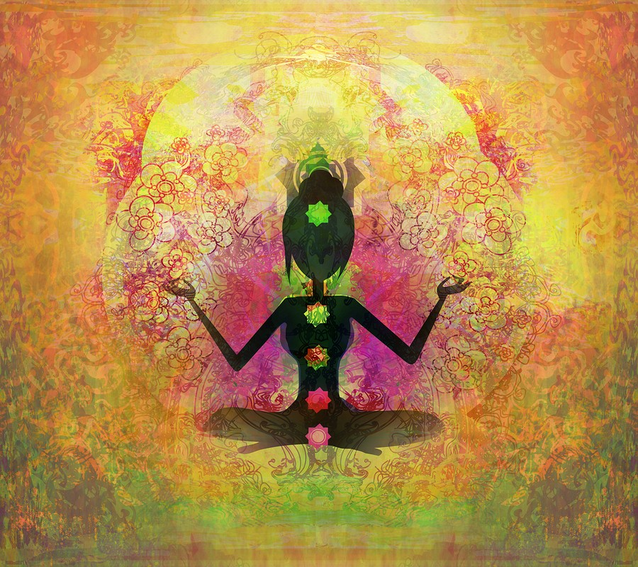 Yoga Lotus Pose Padmasana With Colored Chakra Points.